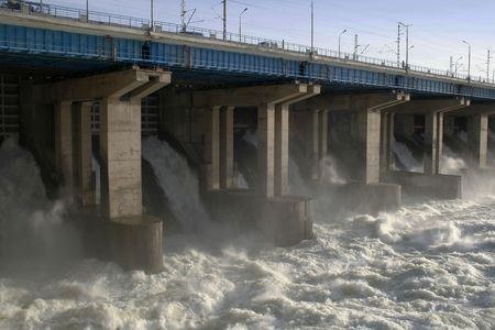 volzhskiy: Water flowing over flood gates of a dam