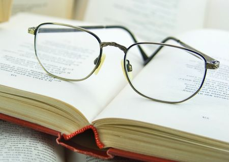 Book  and Glasses on it photo