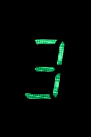 digital number three in green on black background Stock Photo - 5117765