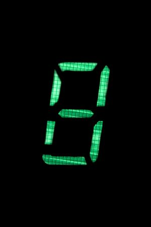 digital number eight in green on black background photo