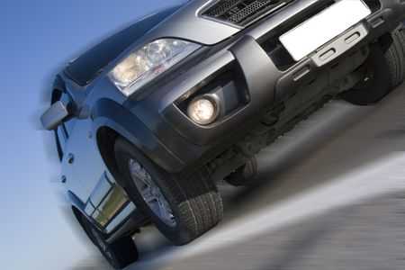 Modern SUV moving with motion blur Stock Photo - 5217098