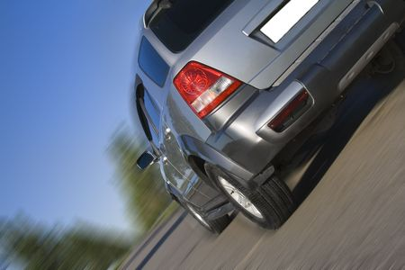 Modern SUV moving with motion blur Stock Photo - 5217101
