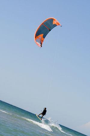 Kiteboarder enjoy surfing in the sea photo