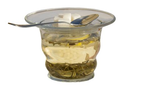 robustness: The cup of green tea isolated over white