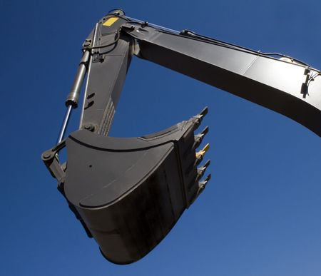 Shovel bucket against blue sky photo