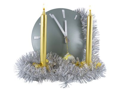 Clock (5 minutes to 12) with christmas  decoration over white photo