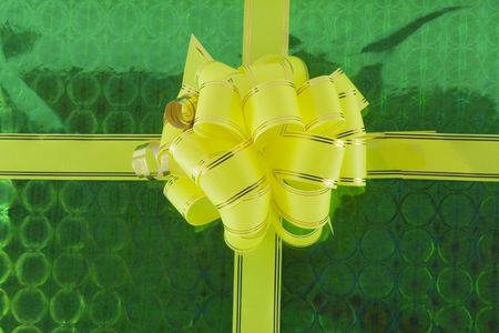yellow holiday bow on green background Stock Photo - 5797538