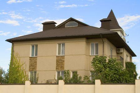 New modern luxury home over big blue sky photo