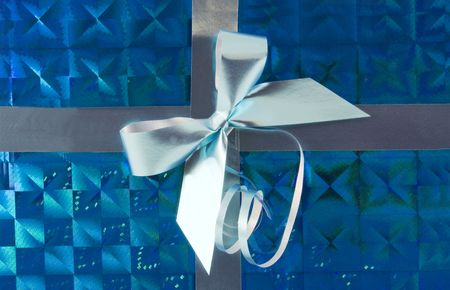 silver holiday bow on blue background photo