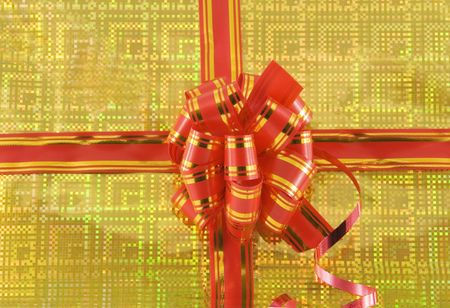 red holiday bow on yellow background Stock Photo - 6023635
