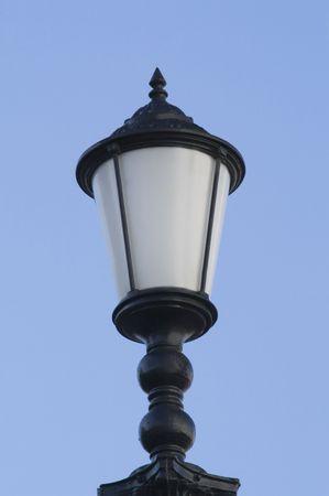 Street lamp isolated on blue sky photo