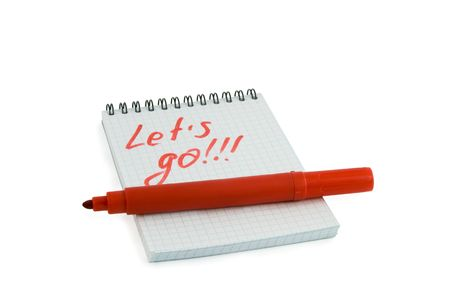 Red marker and notebook isolated over white photo