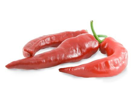 Three red hot chili peppers over white background photo