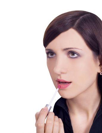 picture of beautiful woman applying lipstick using lips brush photo