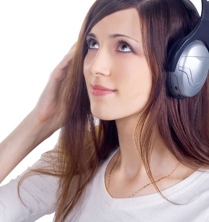 Young woman in headphones listening music Stock Photo - 6369984