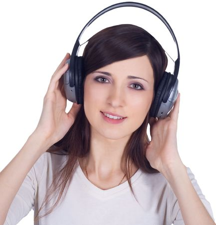 Young woman in headphones listening music photo