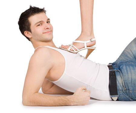 Brightly picture of young man holding female leg in high heels Stock Photo - 6419348
