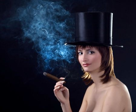 backlight picture  of topless brunettel smoking cigar Stock Photo - 6649848