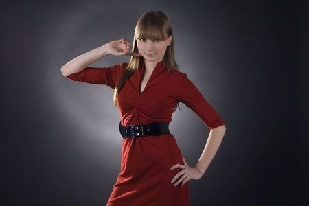 stunning woman in red dress on black background Stock Photo - 6649801