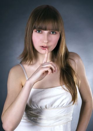 picture of lovely woman with finger on lips Stock Photo - 6861378