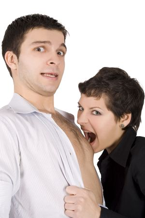 masochism: brunette embracing man and going to bite him Stock Photo