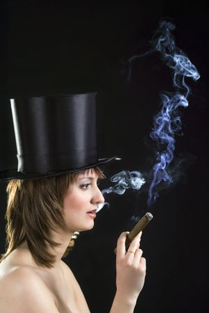 backlight picture of topless brunettel smoking cigar Stock Photo - 7026680