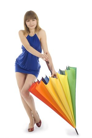 greeneyes: Lovely young green-eyes lady in blue dress standing with color umbrella Stock Photo