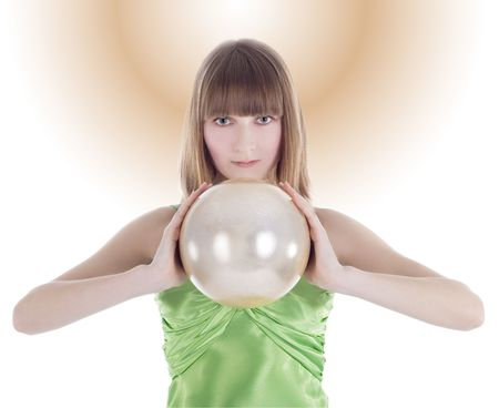 Beautiful woman with gold sphere in hand photo