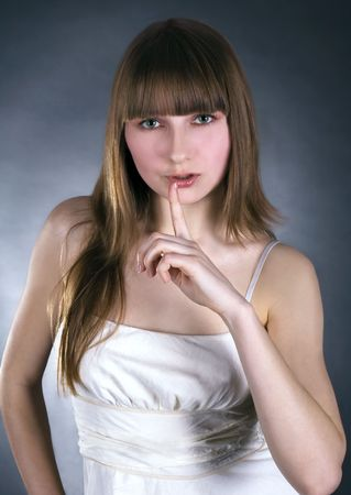 picture of lovely woman with finger on lips Stock Photo - 6944299