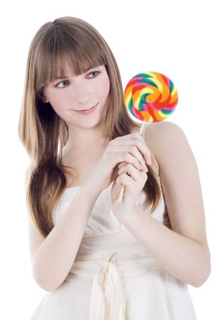 sugarplum: Bright picture of hungry blonde with color lollipop Stock Photo