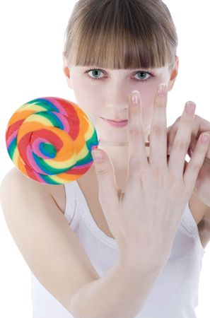 Bright picture of hungry blonde with color lollipop photo