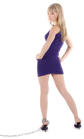 Sexy blonde in purple dress on high heel shoes in chains