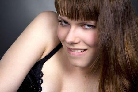 Beautiful brunette girl posing in studio on dark background Stock Photo - 7017552