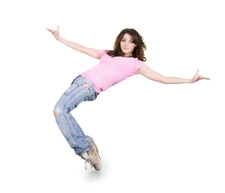 Teenage girl dancing hip-hop over white photo