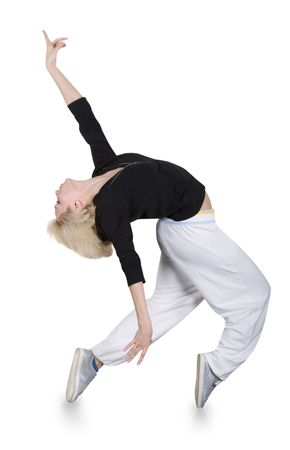 Teenage girl dancing hip-hop over white background Standard-Bild