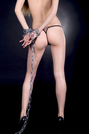 Topless sexy brunette in chains