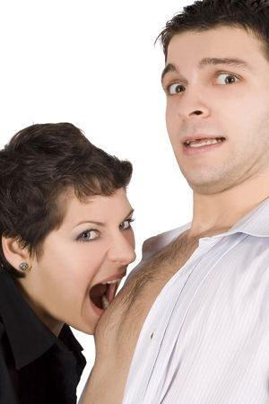 domination: brunette embracing man and going to bite him Stock Photo