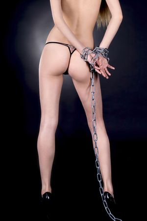 Topless sexy brunette in chains Stock Photo - 7108319