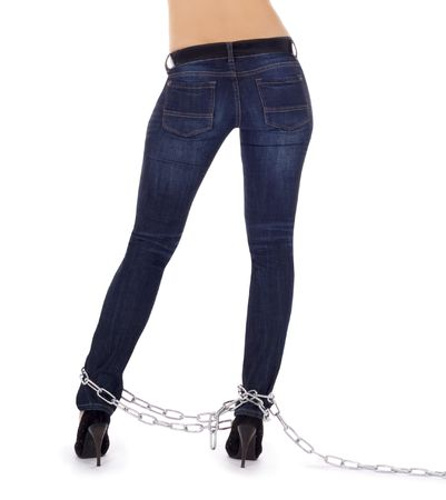 Sexy female body in high heel shoes in chains Stock Photo - 7184624
