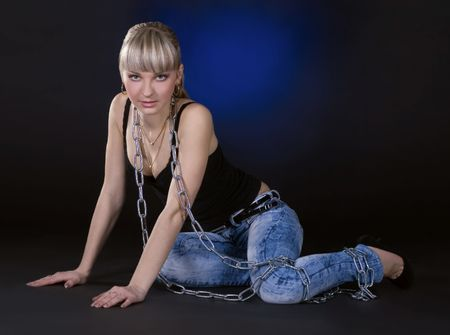 beautiful bdsm: Sexy blonde in chains over black background Stock Photo