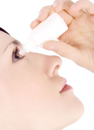 woman dripping eye with eyes drops photo