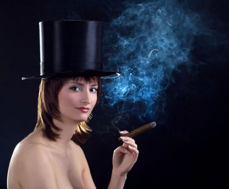 backlight picture  of topless brunettel smoking cigar photo