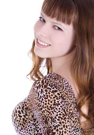 Red-hair girl in leopard dress posing over white photo