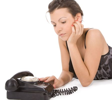 young woman looking at old phone waiting for a call photo