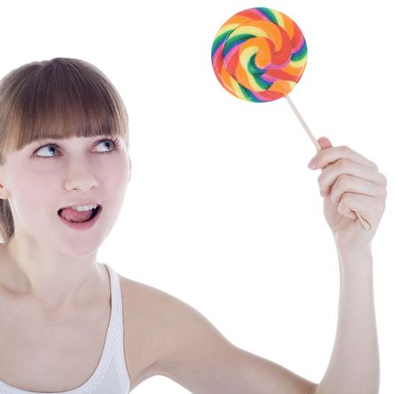 Bright picture of happy blonde with color lollipop photo