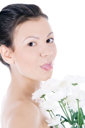 Beautiful portrait of a young sexy woman with a white flower. photo