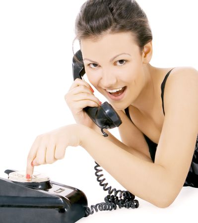 young alluring girl calling at the phone photo