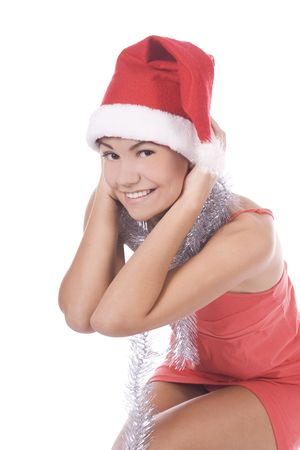 Portrait of beautiful brunette young woman wearing santa claus hat   photo