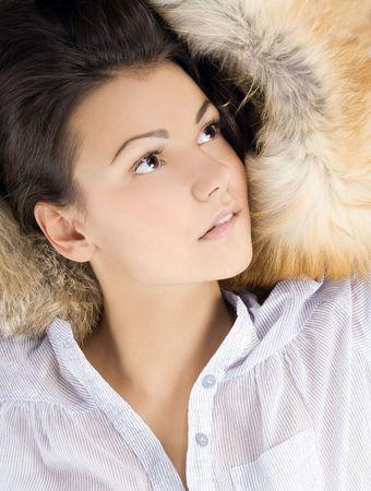 beautiful young woman lying in a fur  photo