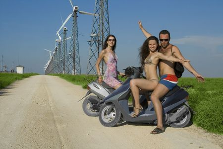 people driving bicycle on the road in wind farm. Stock Photo - 8246155